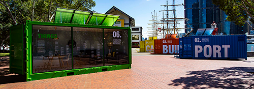 Containers in situ outside Wharf 7 with the museum building in the background